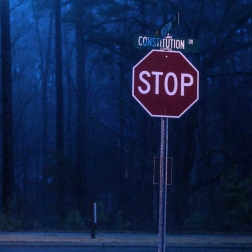 ​$200,000 settlement for a motorist's failure to obey a stop sign.